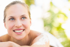 Close up portrait of a beautiful young woman on massage table Stock Photo