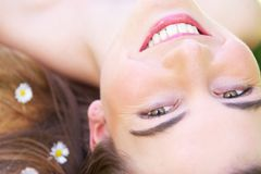 Close up portrait of a beautiful young woman smiling Stock Image