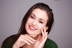 Close up beautiful young woman smiling with hands on face. Close up portrait of beautiful young woman smiling with hands on face Stock Photos