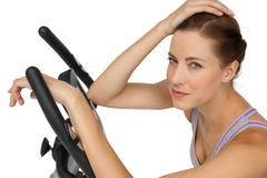 Close-up portrait of a beautiful young woman on stationary bike Royalty Free Stock Photo