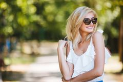 Close-up portrait of a beautiful young woman in sunglasses in a summer park. Optics style. Beauty, fashion outdoor Royalty Free Stock Images