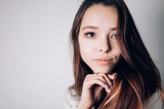 Close up portrait of beautiful young woman on white background. Horizontal, copyspace. Youth and Skin Care stock image