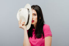 Close-up portrait of a beautiful young woman with white hat Stock Image