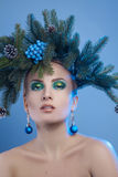 Close up portrait of beautiful young woman with xmas tree-wreath Royalty Free Stock Image