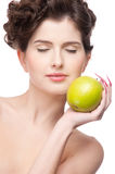 Close up portrait of beauty woman with apple Stock Photography