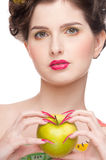 Close up portrait of beauty woman with apple. Close up portrait of young beauty woman with fruit bodyart and green apple . Isolated on white Royalty Free Stock Photography