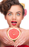 Close up portrait of beauty woman with grapefruit Stock Photography