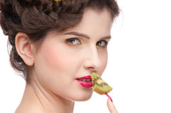 Close up portrait of beauty woman with kiwi Royalty Free Stock Photography