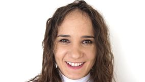 Close up portrait of beauty young woman with brown eyes, smiling looking at camera. slow motion. 3840x2160 stock video