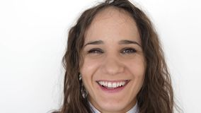 Close up portrait of beauty young woman with brown eyes, smiling looking at camera on a white background. slow motion stock footage