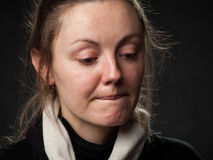 Close up portrait  of  bemused lady. Close up portrait of a young sad disoriented woman , grey background Royalty Free Stock Photo