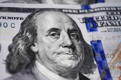 Close up portrait of Benjamin Franklin on hundred dollar baknote. Photo, macro royalty free stock photo