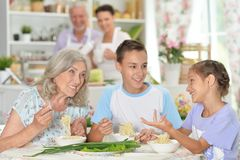 Close up portrait of big happy family having breakfast stock images