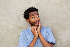 Close up portrait of black man with hands to face in amazed expression Royalty Free Stock Image