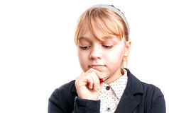 Close-up portrait of blond Caucasian thinking schoolgirl Royalty Free Stock Photography