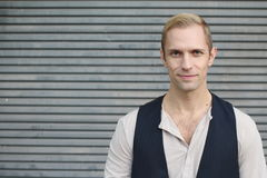 Close up portrait of blond haired handsome male dressed in causal shirt and vest Stock Photo