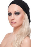 Close up portrait of blond woman in black hat Royalty Free Stock Photography