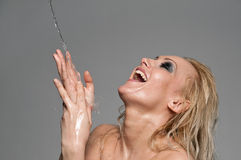 Close up portrait of blond woman play with water Royalty Free Stock Photos