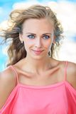 Close-Up Portrait Of Blonde Smiling Woman Stock Photo