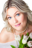Close-up portrait of blonde woman with tulipson is Royalty Free Stock Photography