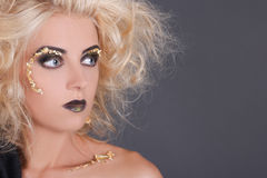 Close up portrait of blondie witch over gray Stock Photo