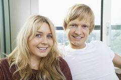 Close-up portrait of blue eyed smiling couple at home Royalty Free Stock Images