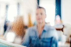 Portrait, blurred out details of window cleaning. Soap detergent and cloth on window glass. Close up portrait, blurred out details of window cleaning. Soap royalty free stock images