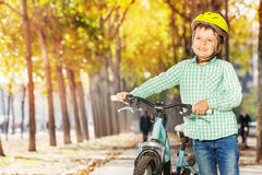 Close-up portrait of boy with bike at autumn park Royalty Free Stock Image