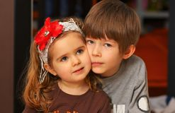Close up portrait of boy and girl cuddling cheek to cheek. Close up portrait of boy and girl brother and sister cuddling cheek to cheek Royalty Free Stock Photos