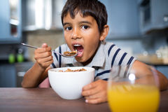 Close up portrait of boy having breakfast at home Royalty Free Stock Photography