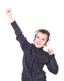 Close up portrait of boy listening to music with headphones Stock Image