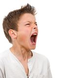 Close up portrait of boy shouting Stock Images