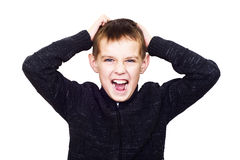 Close-up portrait of boy shouting madly with his hands over his Royalty Free Stock Photo
