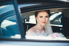 Close-up portrait of a bride in car window Royalty Free Stock Photo