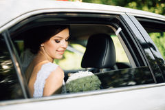 Close-up portrait of a bride in car window Royalty Free Stock Photography