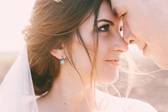 Close up portrait of bride and groom at sunset Stock Photography