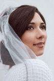 Close-up portrait of bride in white veil. Wedding photo. royalty free stock photos