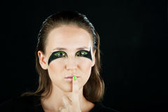 Close-up portrait brunette. Close-up portrait of beautiful brunette with green eye shadow mask Stock Image