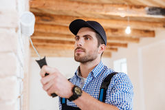 Close-up portrait of a builder worker painting wall indoors Royalty Free Stock Photography