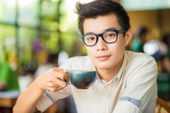 Close up portrait of business asian man drinking coffee in vinta Stock Photography
