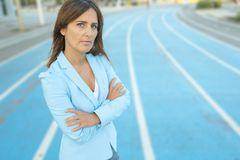 Close up portrait of business woman arms crossed. In blue jacket Stock Photos