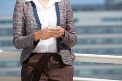 Close up portrait of a business woman holding cell phone Stock Photography