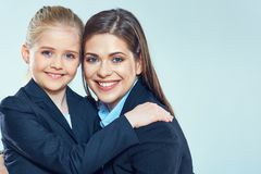 Close up portrait of business woman with little girl. Close up portrait of business women with little girl. Mother and daughter Stock Photography
