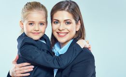 Close up portrait of business woman with little girl. Close up portrait of business women with little girl. Mother and daughter Stock Photo