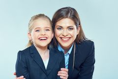 Close up portrait of business woman with little girl. Close up portrait of business women with little girl. Mother and daughter Royalty Free Stock Photography