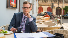 A close-up portrait of a businessman having breakfast. Stock Photo