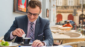A close-up portrait of a businessman having breakfast. Royalty Free Stock Images