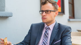 A close-up portrait of a businessman having breakfast. Stock Photography