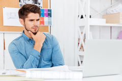 Close up portrait of a businessman sitting at the desk Royalty Free Stock Image