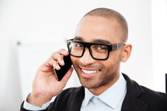 Close-up portrait of businessman talking on the mobile phone. Close-up portrait of a businessman talking on the mobile phone looking at camera Stock Photography